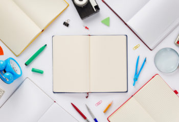 school accessories and notebook or book with empty pages on white  background, top view
